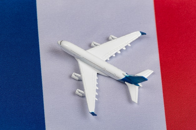 Flag of france and toy plane. concept of air travel in france. air travel in europe after quarantine
