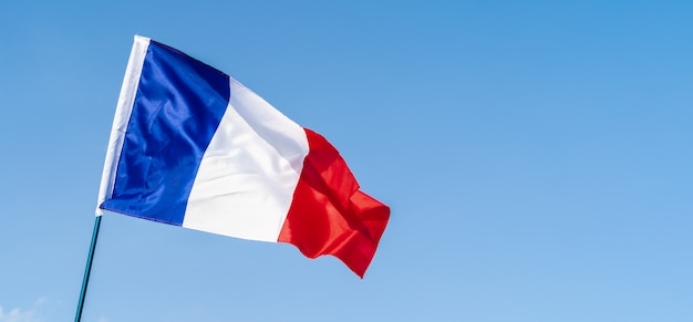 Flag of france waving in the wind in the sky
