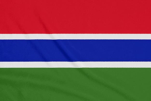 Flag of gambia on textured fabric. patriotic symbol