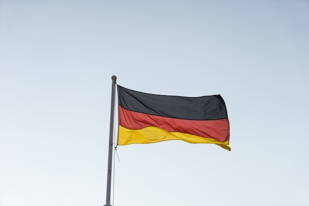 Flag of germany in afternoon sky.