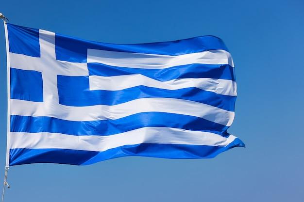 Flag of greece - close-up of waving greek flag agaist the blue sky