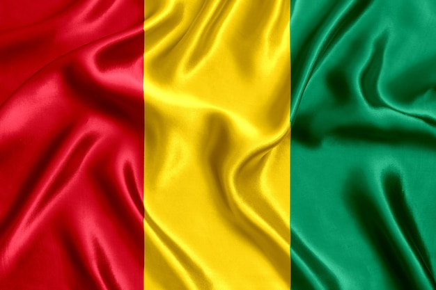 Flag of guinea silk close-up background
