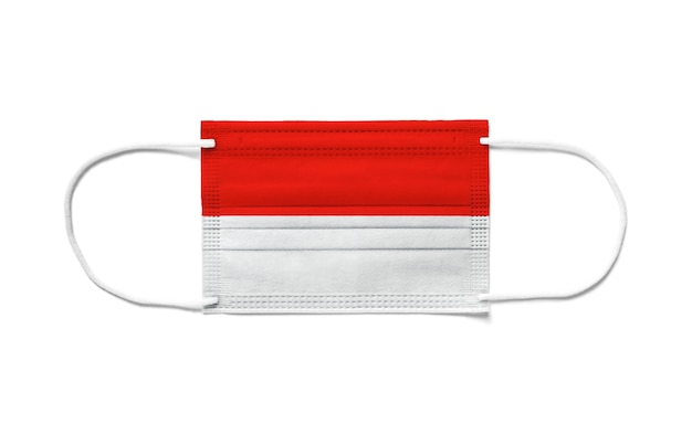 Flag of indonesia on a disposable surgical mask. white background isolated