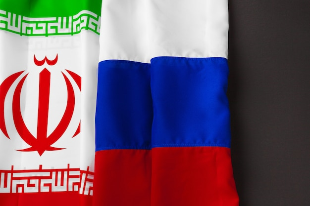 Flag of iran and russia together on black