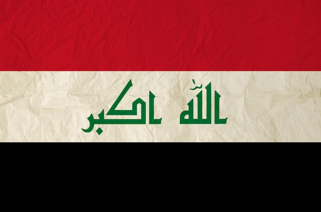 Flag of iraq with vintage old paper texture