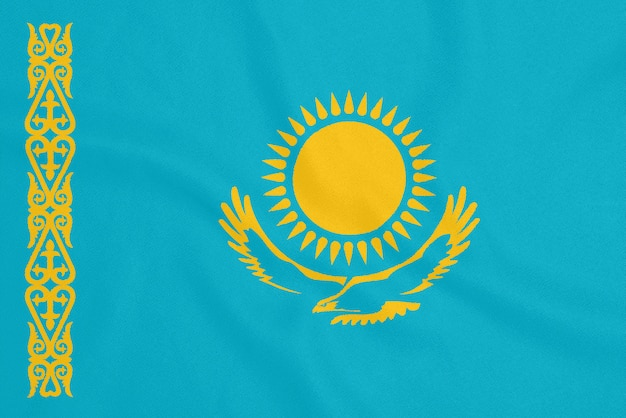 Flag of kazakhstan on textured fabric. patriotic symbol