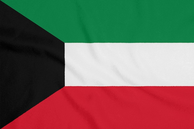 Flag of kuwait on textured fabric.
