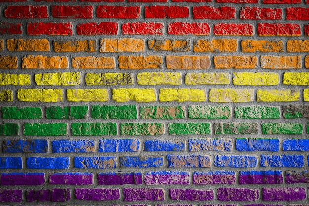 Flag of lgbt  on an old brick wall flag  banner on brick wall background