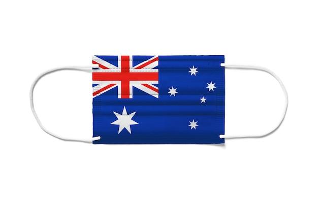 使い捨てサージカルマスクにオーストラリアの旗。分離された白い背景