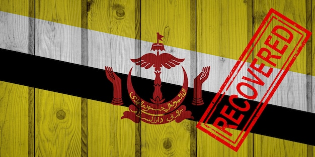 Флаг брунея, который выжил или оправился от инфекций, вызванных эпидемией коронавируса или коронавируса. флаг гранж с печатью восстановлено