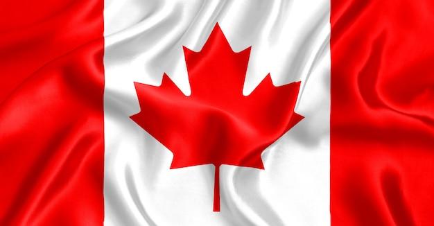カナダの旗のシルクのクローズアップの背景
