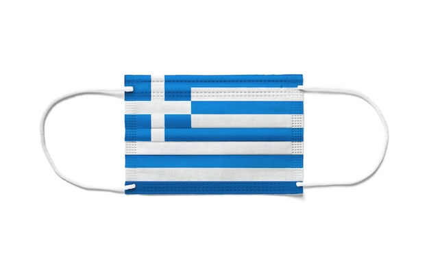 使い捨てサージカルマスクのギリシャの旗。分離された白い背景