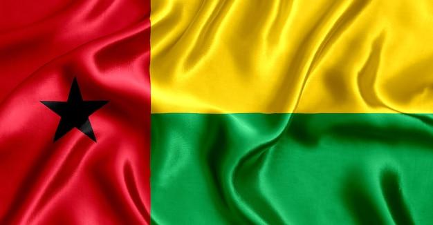 기니 비사우 실크 근접 배경의 국기