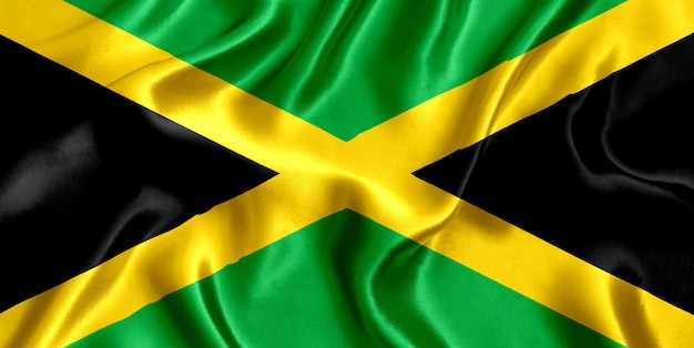 ジャマイカの国旗のシルクのクローズアップの背景