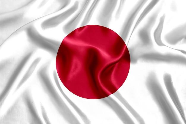 Флаг японии шелк крупным планом фон