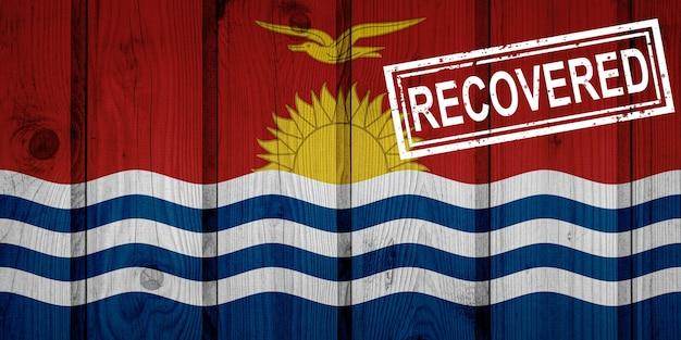 Флаг кирибати, который выжил или оправился от инфекций, вызванных эпидемией коронавируса или коронавируса. флаг гранж с печатью восстановлено