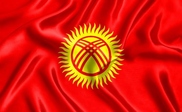 キルギスタンの国旗のシルクのクローズアップの背景