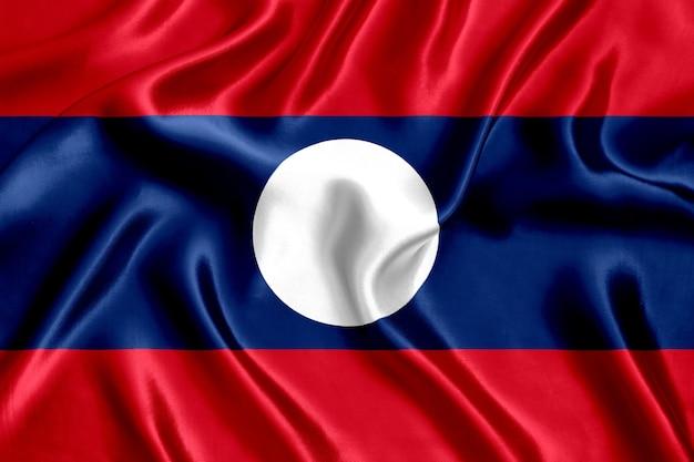 ラオスの旗のシルクのクローズアップの背景