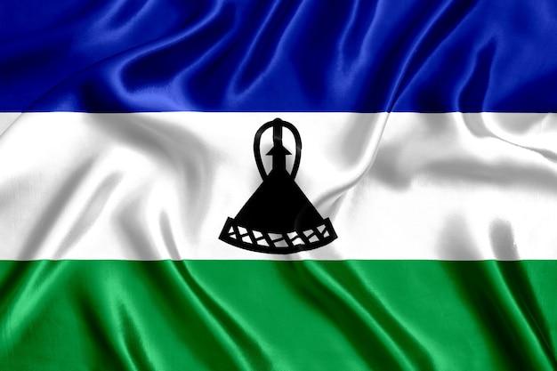 레소토 실크 근접 배경의 국기