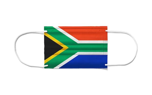 使い捨てサージカルマスクに南アフリカの旗。分離された白い背景