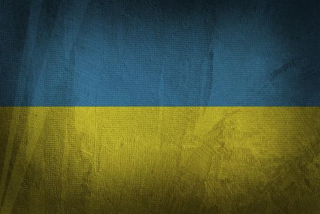 暗いテクスチャ背景にウクライナの旗
