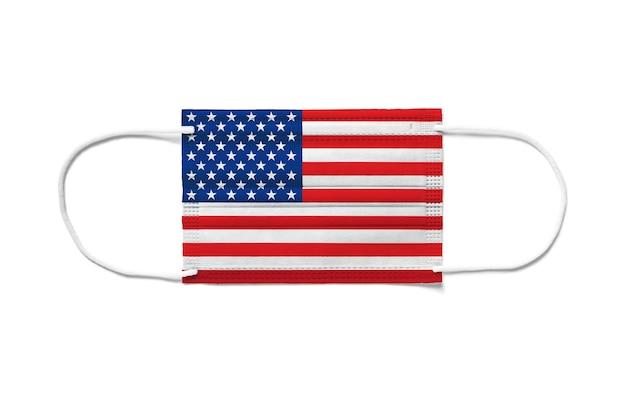 使い捨てサージカルマスク上の米国の旗。分離された白い背景