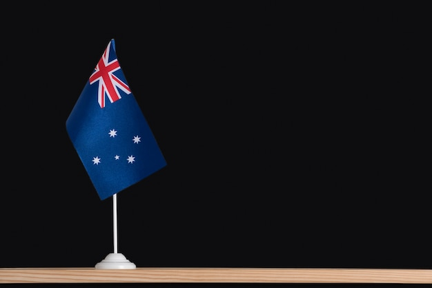 Flag pole. national table flag of australia on black background.