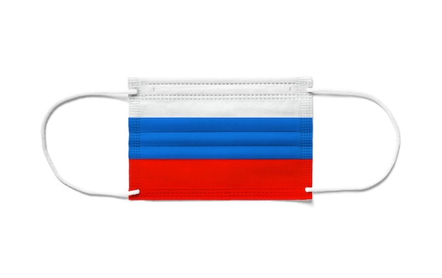 Flag of russia on a disposable surgical mask. white background isolated