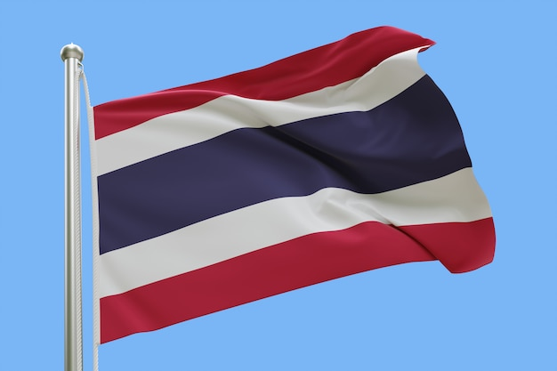 Flag of thailand on flagpole waving in the wind isolated on blue background