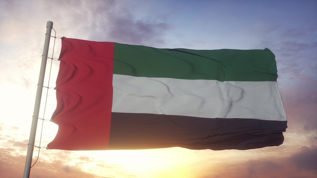 Flag of united arab emirates waving in the wind against deep beautiful sky at sunset. 3d rendering.