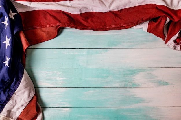 The flag of the united sates of america on a blue wooden background Premium Photo