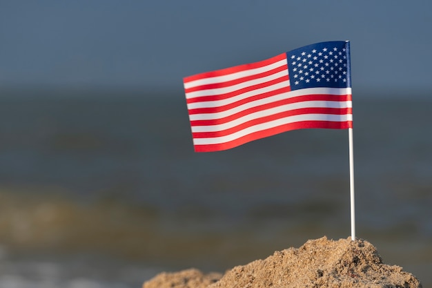 Flag of usa on the beach. national flag of america, sea background.