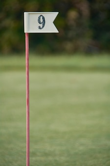 Flag with number 9 used in the sport of golf to mark the hole of the corresponding number