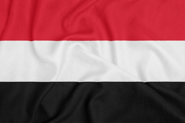 Flag of yemen on textured fabric