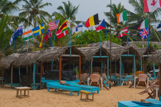 Flags of all countries of the world on the beach