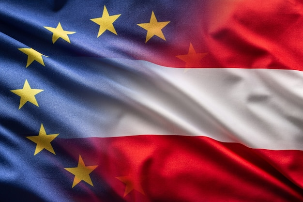 Flags of austria and eu blowing in the wind.