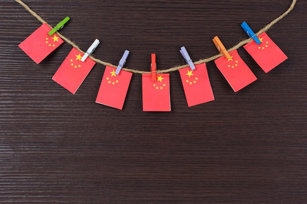 Flags of china on clothesline attached with wooden clothespins