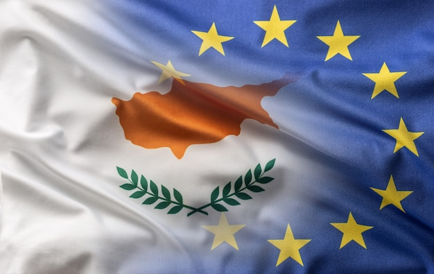 Flags of cyprus and eu blowing in the wind.