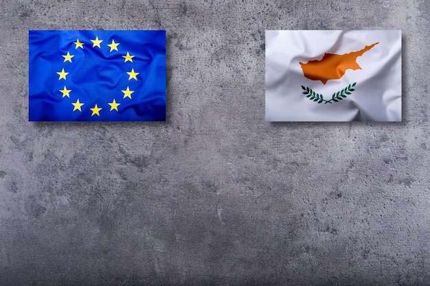 Flags of the cyprus and the european union on concrete background.