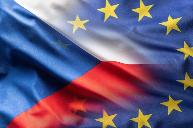 Flags of czech republic and eu blowing in the wind.