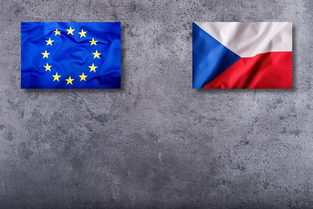 Flags of the czech republic and the european union on concrete background.