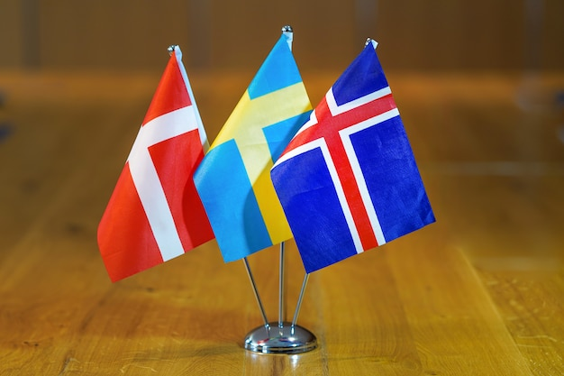 Flags of denmark, sweden and iceland.