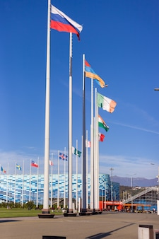 Flags of different countries on flagpoles on the square