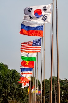 Flags different countries on high flagpoles