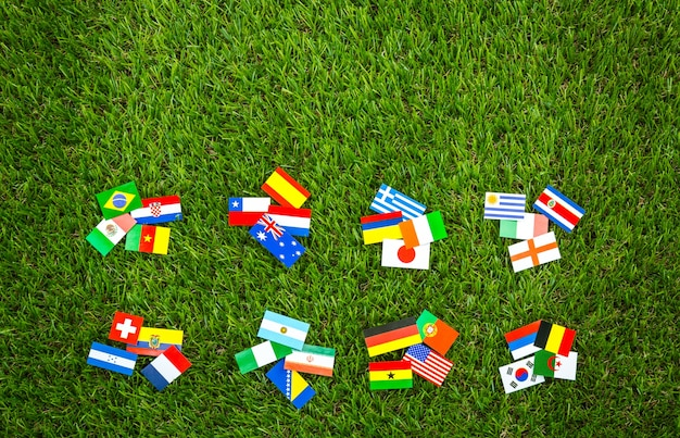 Flags of different countries on a wooden table