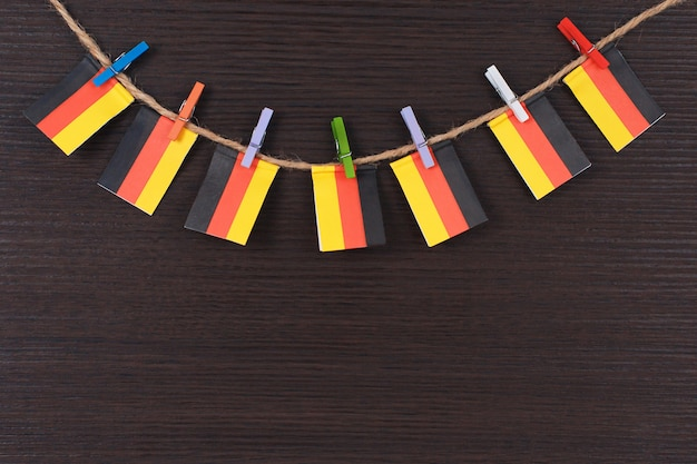 Flags of germany on clothesline attached with wooden clothespins