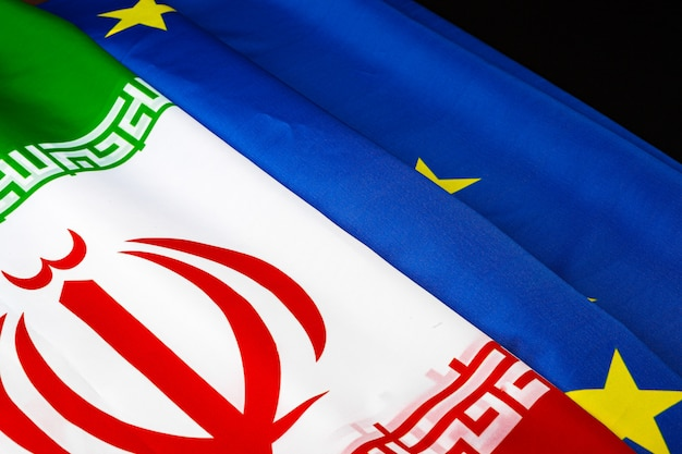 Flags of iran and european union flag together