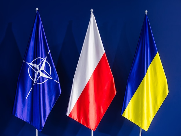 Flags of nato, poland and ukraine at the nato summit in warsaw