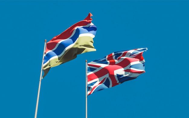 푸른 하늘에 감비아와 영국 영국의 깃발. 3d 아트 워크