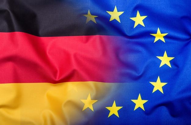 독일과 유럽 연합의 깃발입니다. 독일 국기와 eu 국기. 세계 플래그 돈 개념입니다.